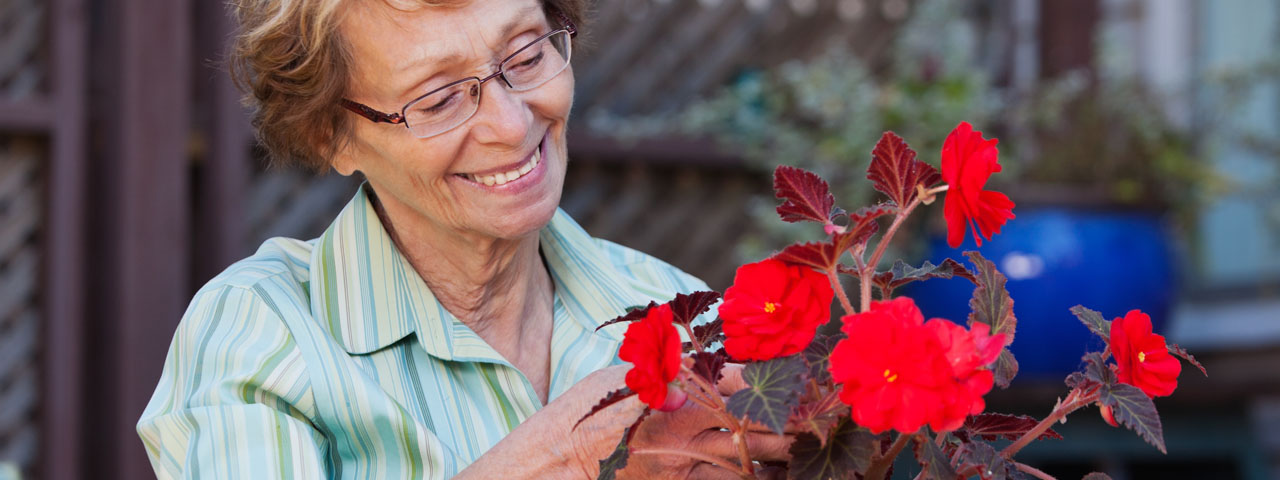 Senior-Woman-with-Flowers-1280x480