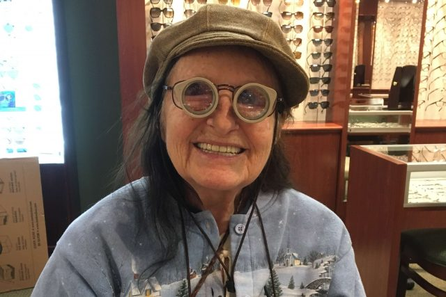 older woman wearing low vision eyeglasses