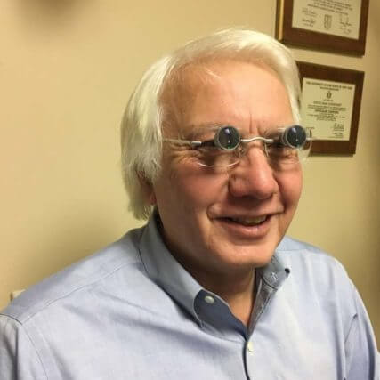 low vision patient wearing lv glasses