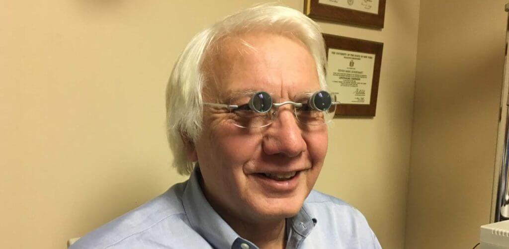 happy senior man wearing lv glasses