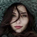 girl with dry eyes, in winter coat