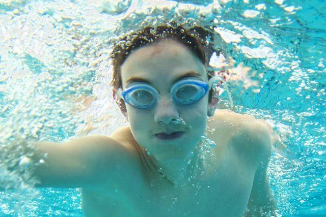 Boy wearing swimming goggles