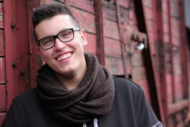 Man smiling, wearing eyeglasses