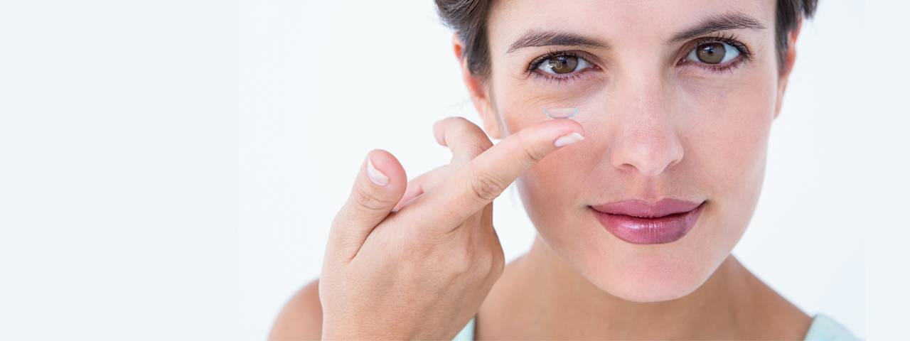 Woman Holding Contact Lens 1280x480