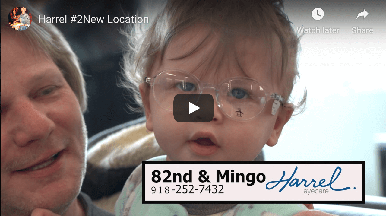 cute toddler trying on glasses after pediatric eye exam