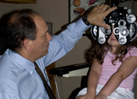 child having eye exam