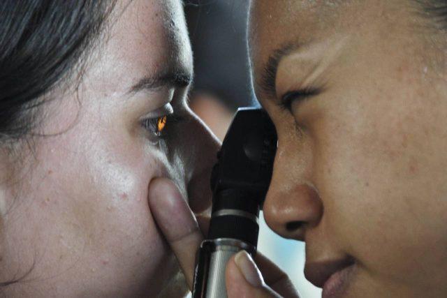 Eye doctor, woman getting her eyes checked in San Antonio, TX