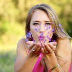 Eye doctor, woman blowing flowers in San Antonio, Texas