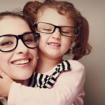 Picture of happy mother and daughter wearing glasses