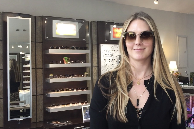 lady wearing designer barton perriera sunglasses