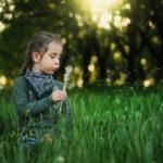 Girl blowing dandelion