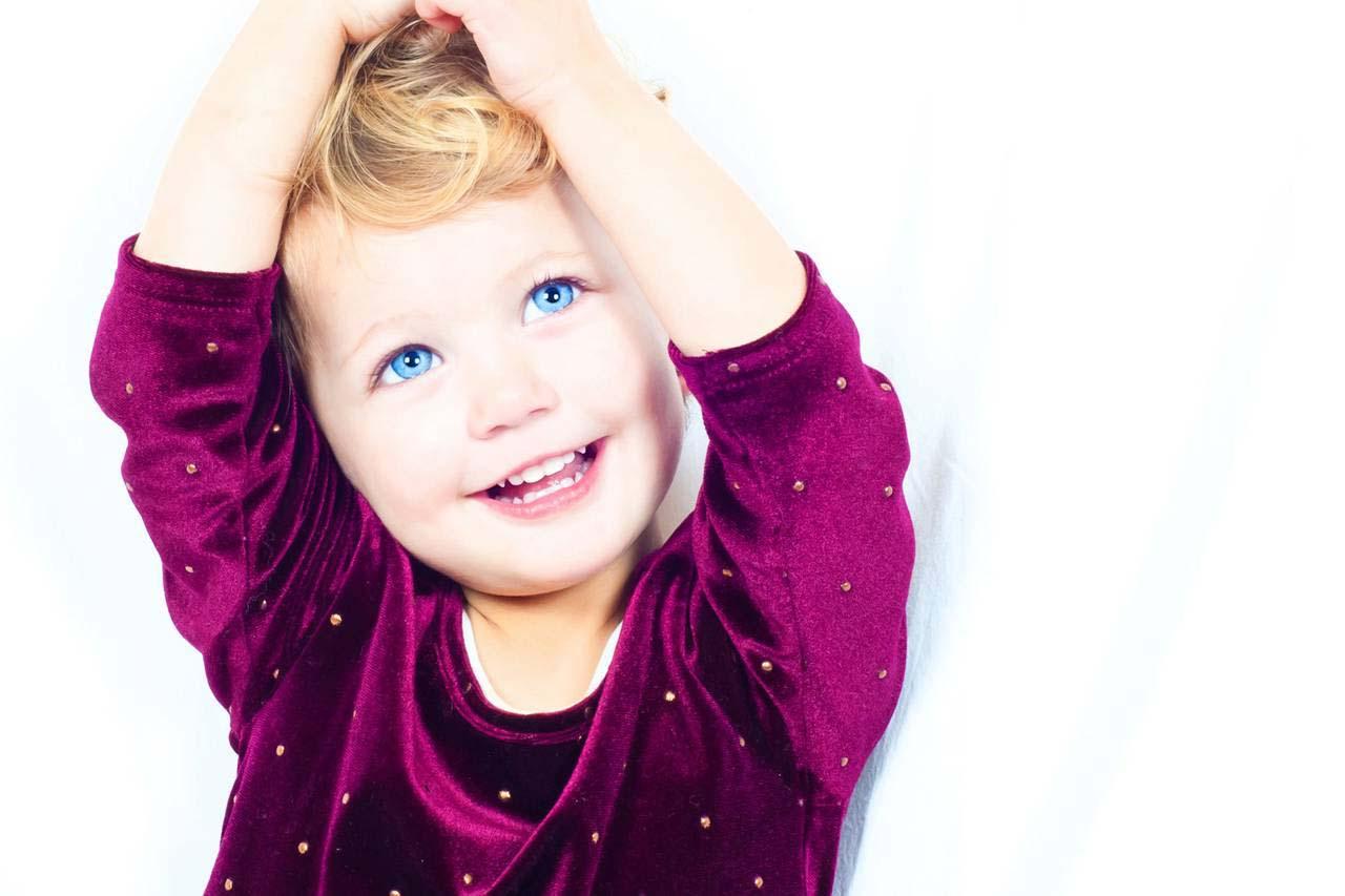 happy blue eyed girl smiling