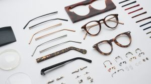 Parts of glasses frame laid out on a white table