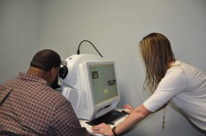 Dr. Kelsea Skidmore taking eye exam of a patient 31 in Houston TX