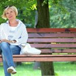 Woman sitting on bench, wearing scleral contact lenses