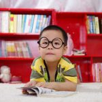 Cute little boy wearing eyeglasses for Myopia