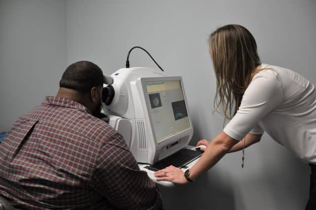 Taking eye exam of a patient 30 in Houston TX opt
