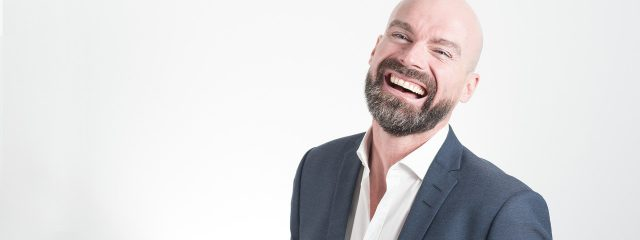Eye doctor, happy man wearing bifocal contact lenses in Houston, TX