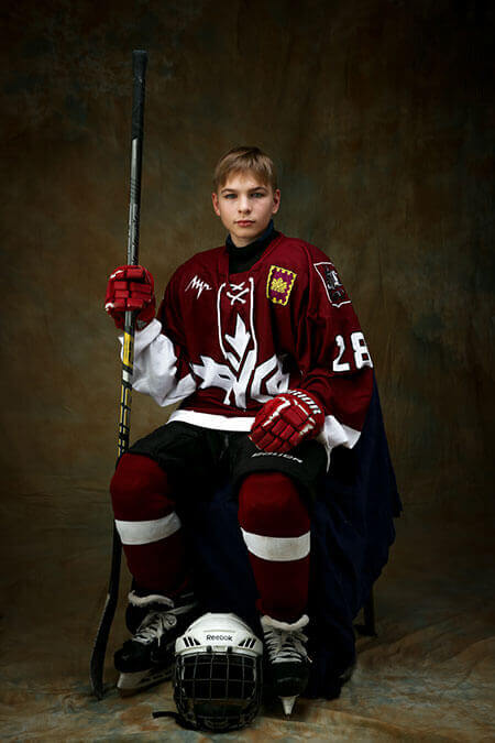 young hockey player in red