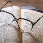 Pair of eyeglasses on a book