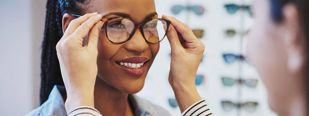 Optometrist, woman trying eyeglasses in Houston, TX