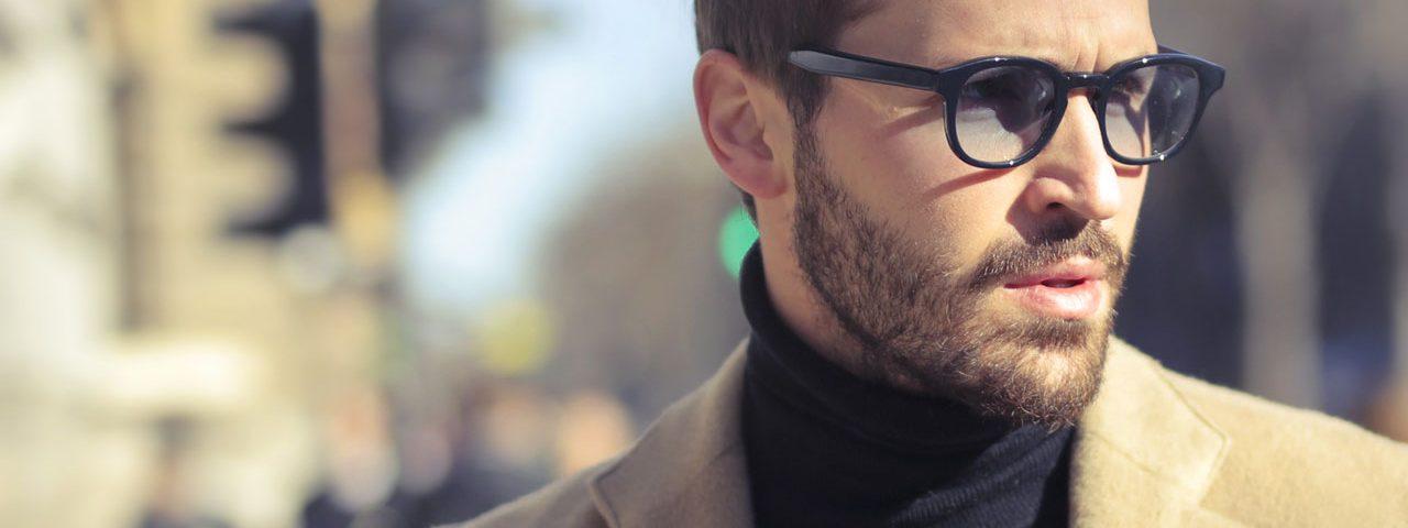Eye doctor, man wearing transitions eyeglasses in Houston, TX