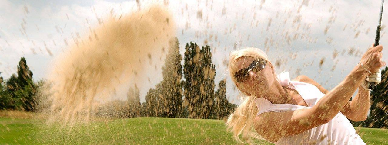 Eye exam, woman playing golf with specialty eyewear in Houston, TX