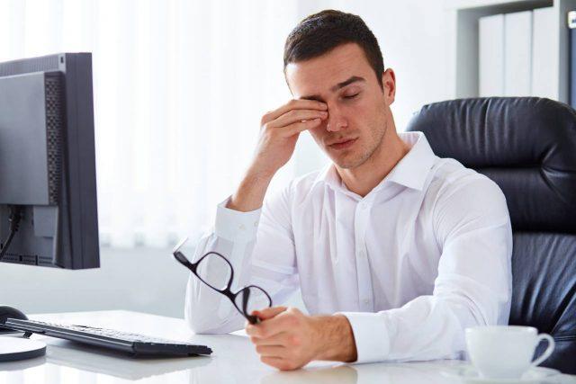 Man wearing eyeglasses, suffering from dry eyes