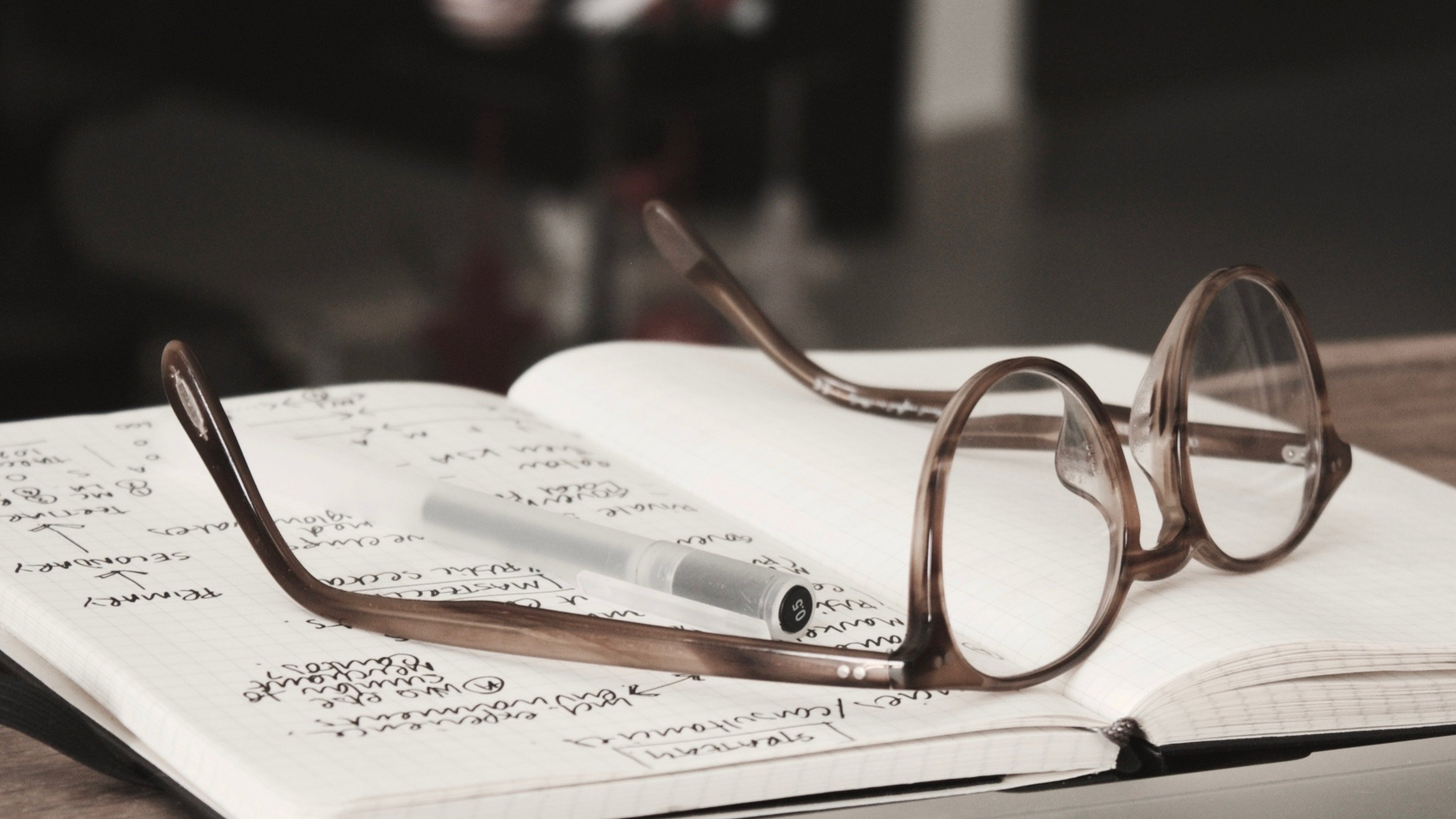 eyeglasses-on-book