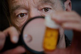 Man Checking Medicine Label Thumbnail 1.jpg