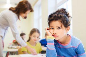 girl sad in a classroom