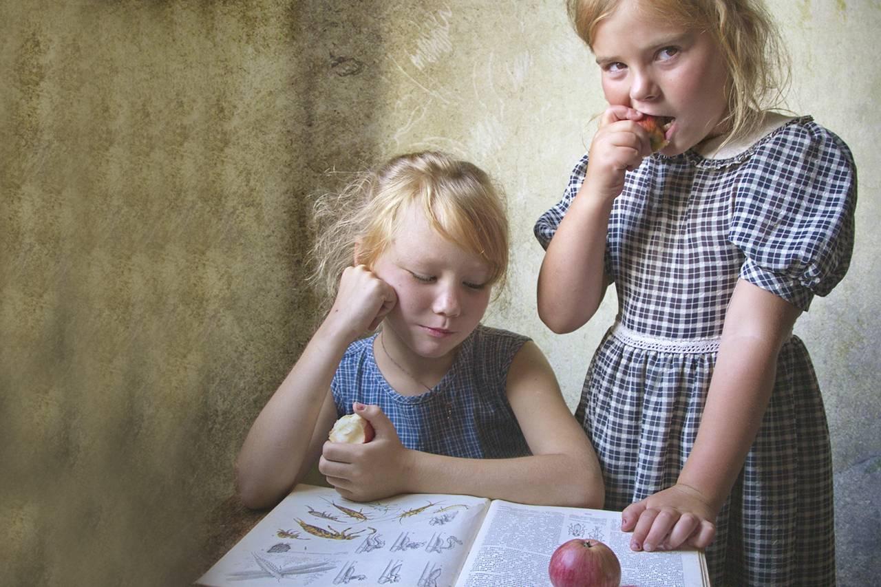 Girls Eating Apples Reading