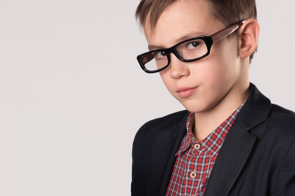 serious boy wearing glasses