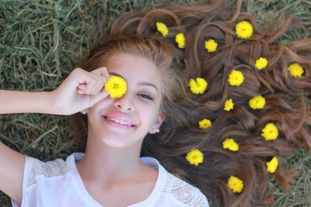 girl with myopia, flowers in hair
