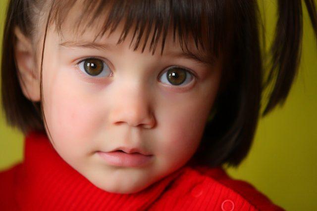 liitle girl in red, suffering from amblyopia in Laguna Beach, California