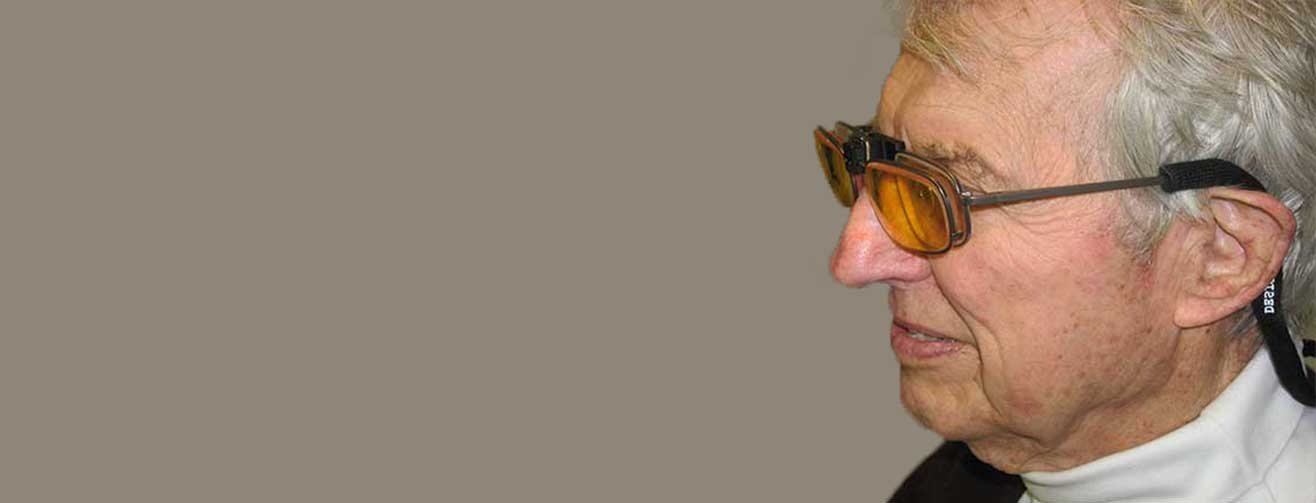 Older man, using Low Vision Glasses