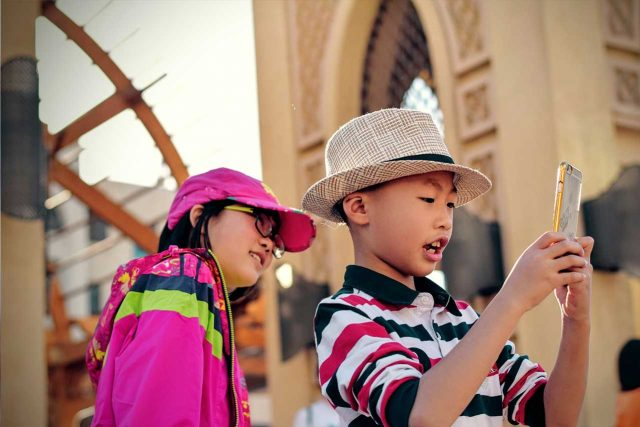eye exam, asian kids with smartphone and dry eye in Laguna Beach, California
