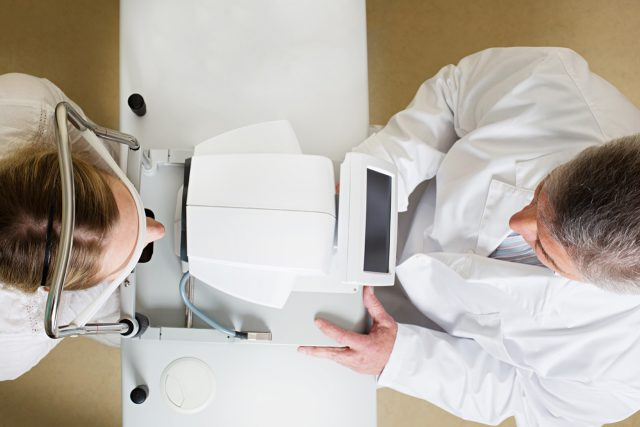 bird's eye view of doctor's eye exam with patient