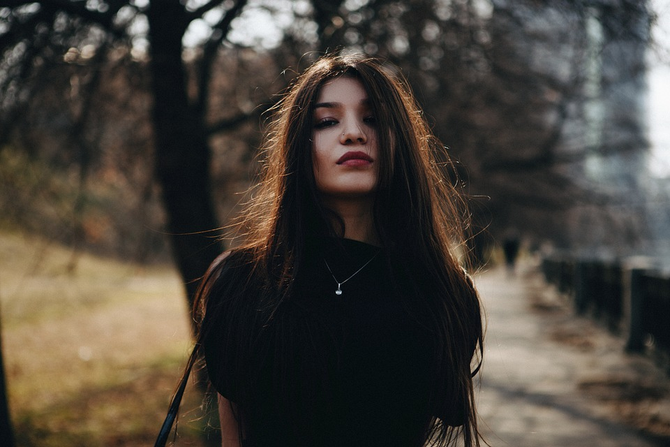 Long-haired woman in forest