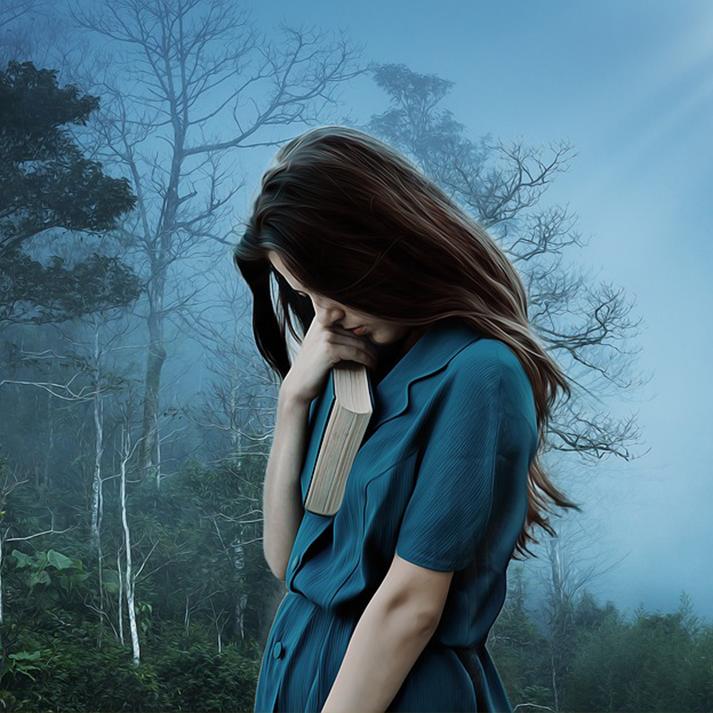 sad girl, holding a book
