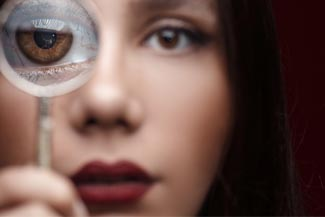 dry eye woman with magnifying glass