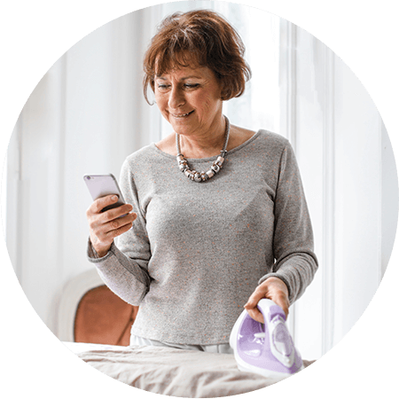 happy-senior-woman-using-smartphone.png