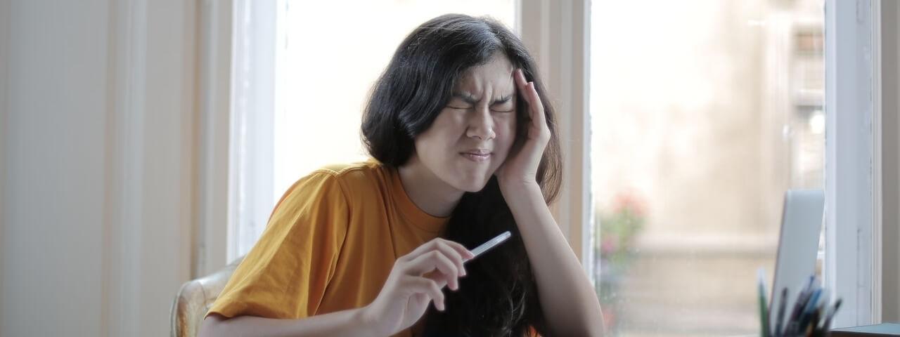 asian girl having a headache