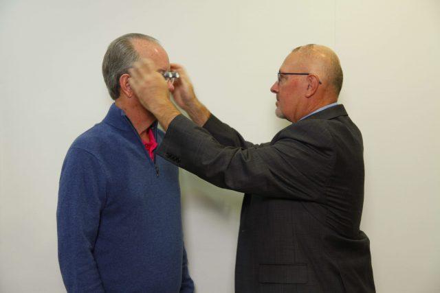 Dr. Evans helping patient