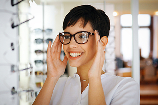 woman trying on glasses 325×217