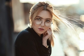 woman wearing designer eyeglasses