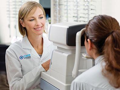 Optometrist giving patient eye exam
