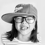 Happy girl, wearing cap and eyeglasses