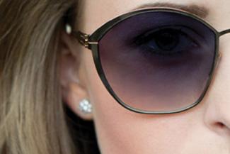 optometrist, woman wearing designer frames in Roselle, IL