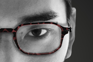 optometrsit, young man wearing prescription eye glasses in Roselle, IL